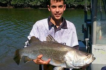 Xaviar and 88 cm Barramundi while estuary fishing